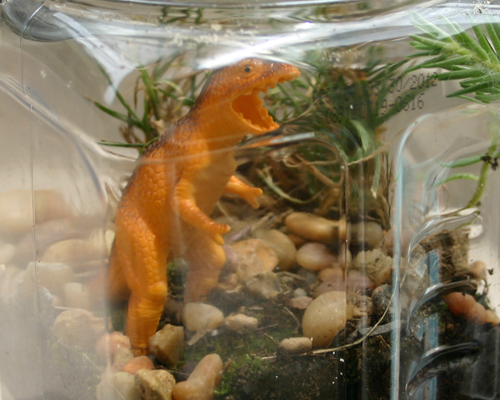 Make a jurassic park terrarium for your child's dinosaur toys
